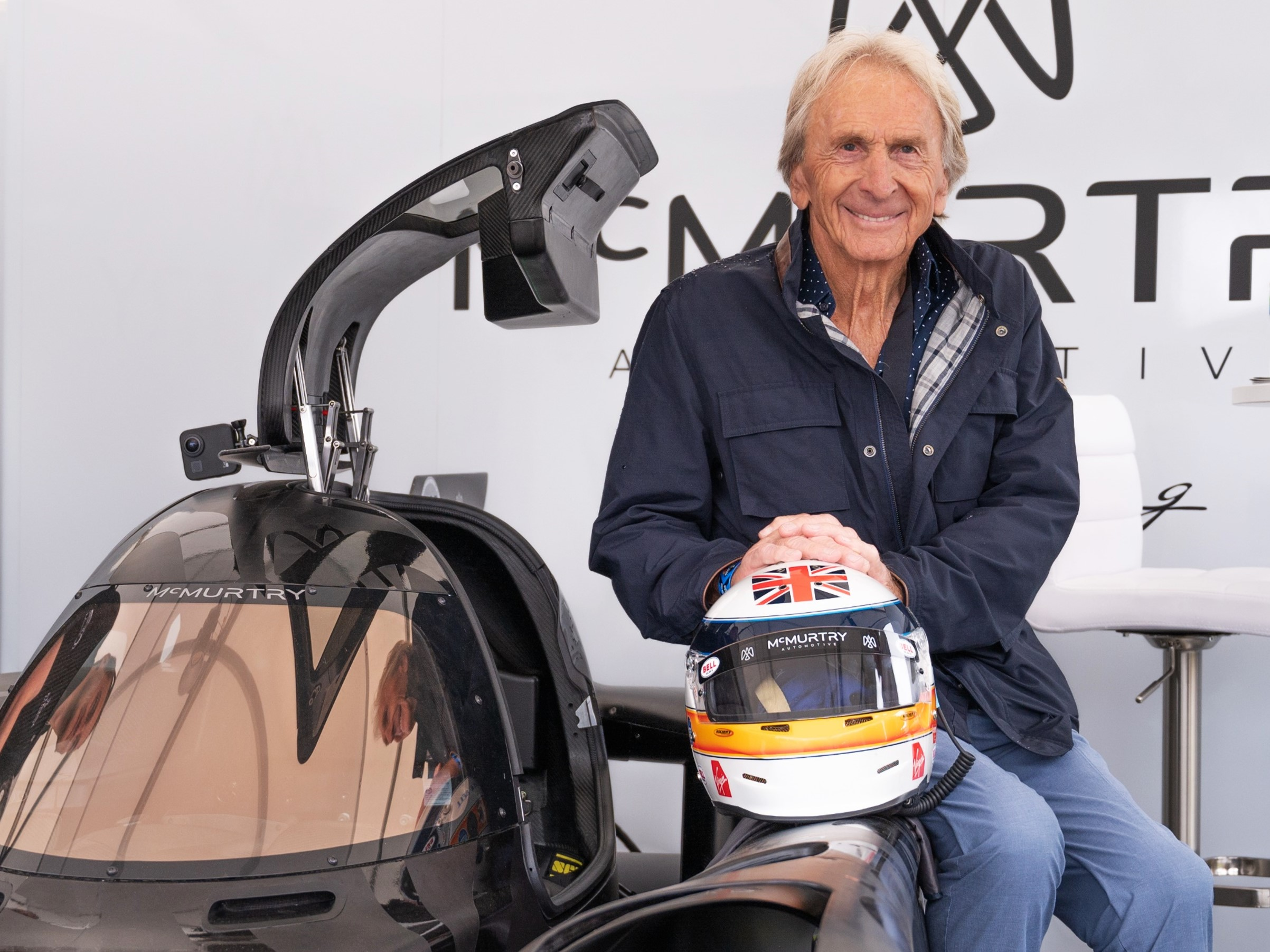 Derek Bell poses with the McMurtry Spéirling at the Goodwood Festival of Speed