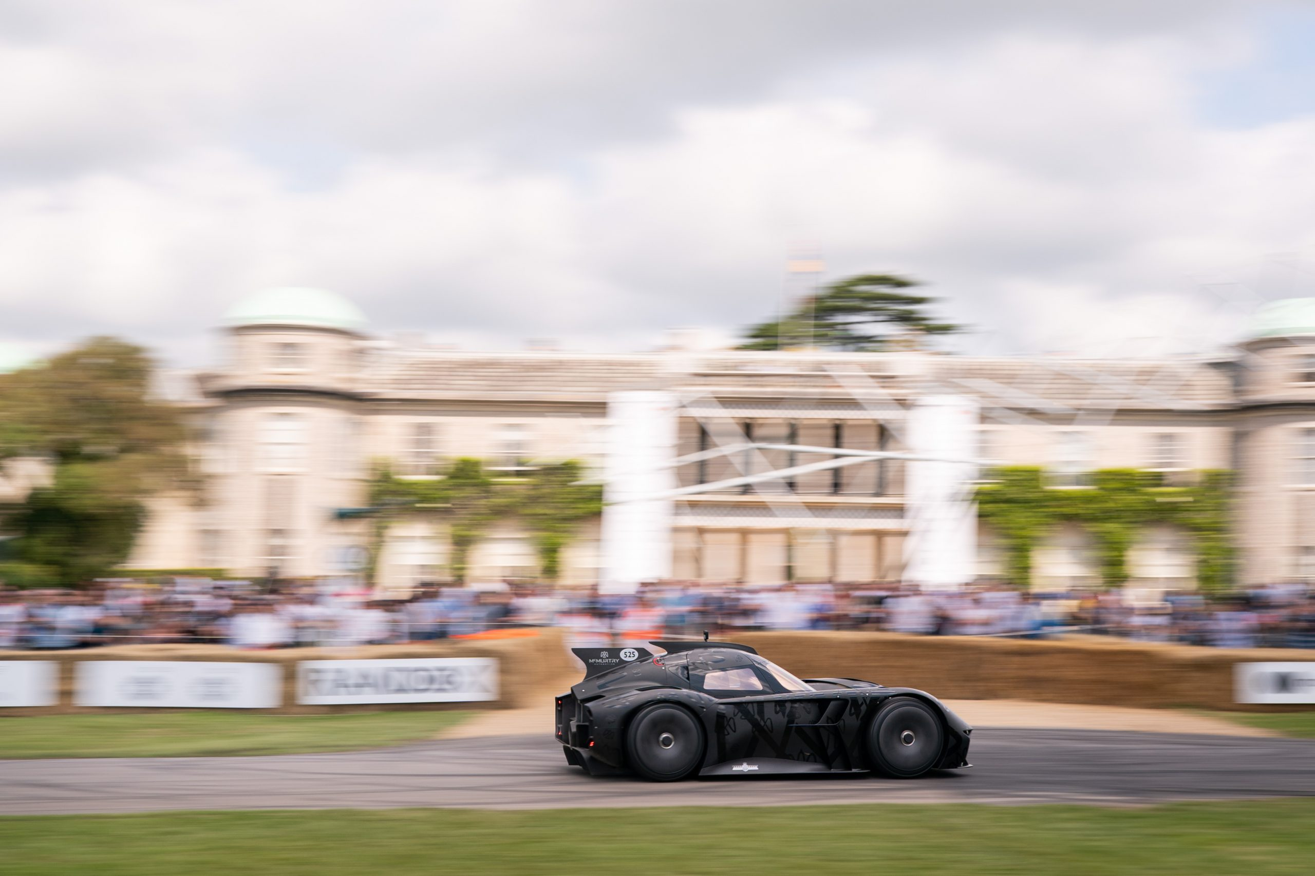 The McMurtry Spéirling flies past Goodwood House on its way up the Hillclimb at the Festival of Speed