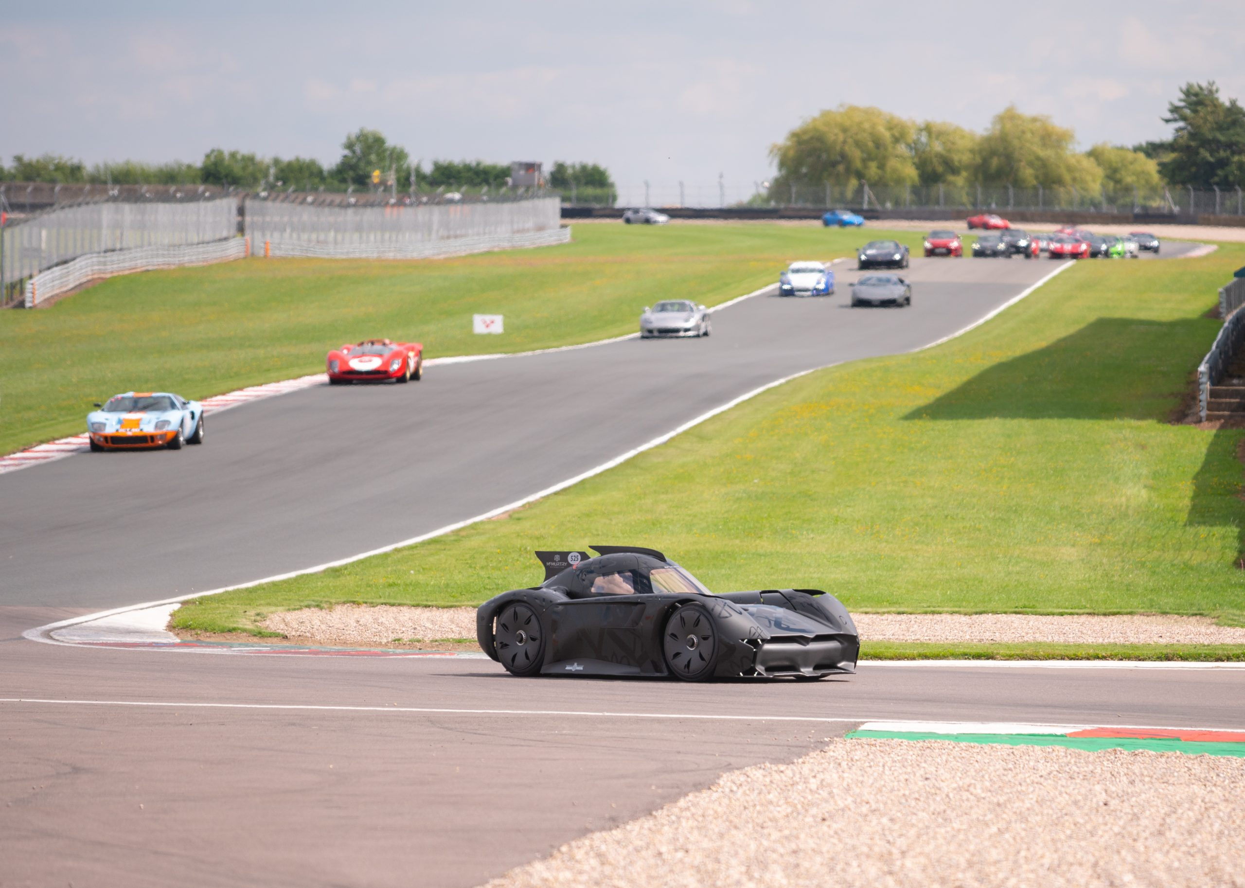 The McMurtry Spéirling taking part in the supercar parade at Donington Park